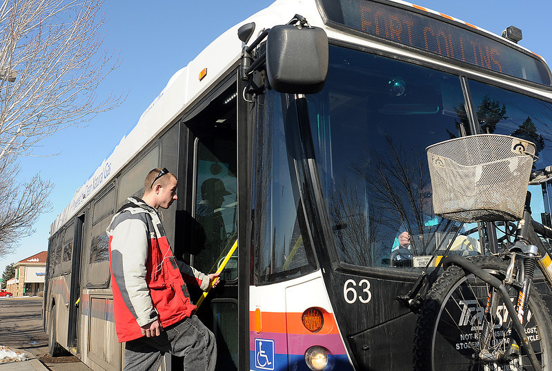 "Loveland resident Jacob Liscum boards the Foxtrot bus Tuesday, Feb. 22, 2010 at the Orchards Shopping Center. Liscum was headed to Fort Collins and said he uses the bus frequently. Of the proposed Longmont route he added, ""I go to Longmont all the time. I wish there was a bus that would take me there."""