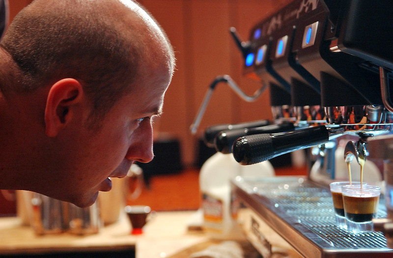 Don Southworth carefully watches the timing and density of his espresso in practice of the day's later competition, Saturday, Feb 13.  From Fluid Coffee Bar in Denver, Southworth is eager to make his signature drink of ginger tea, macadamia nut butter and espresso into a delicious macchiato.