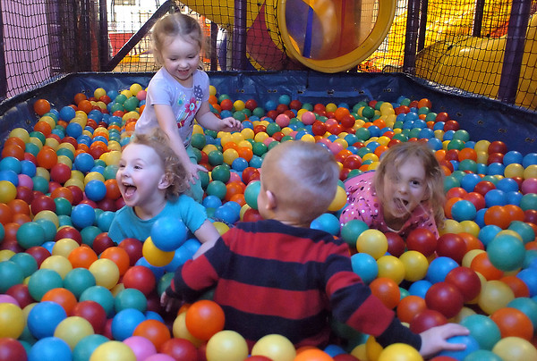 Youngsters play together Thursday afternoon at Monkey Moe's Playhouse, 575 Denver Ave. in Loveland. At rear is Brooke-Lynn Abalos, 2, and front from left are Jaedyn Krager, 2, Jayden Bruce, 3, and Makayla Krager, 4.