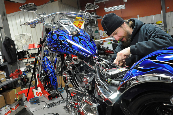 Master Technician Adrian Morin of Thunder Mountain Harley Davidson works on a motorcycles on Tuesday. Engaging Loveland is exploring the viability of holding the Thunder in the Rockies motorcycle rally in downtown Loveland.