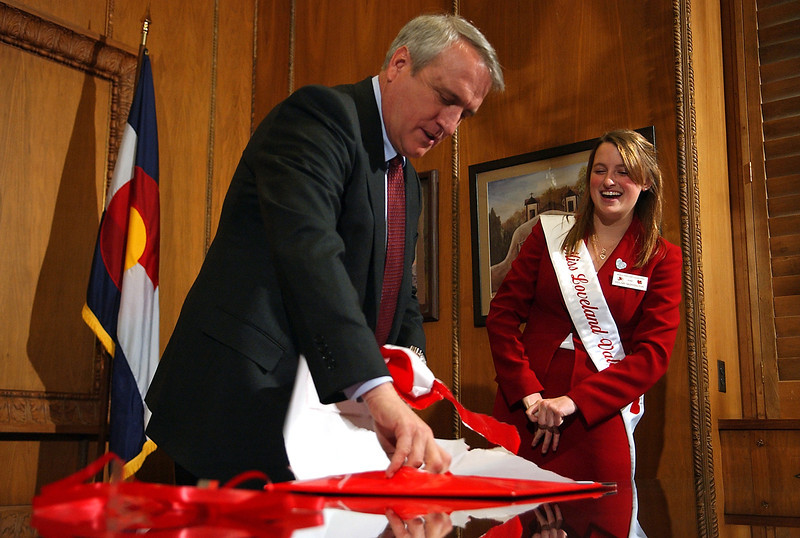 Loveland's Miss Valentine, Hillary Skeffington, presents Gonvor Bill Ritter with an early Valentine during her visit to the Capitol on Tuesday, Feb 10.