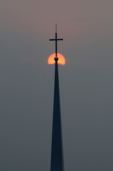 The sun's rays filter through the haze from California wildfires on Monday evening near the Derby Hill Baptist Church.