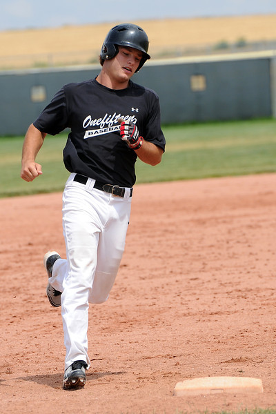 Onefifteen's Luke Engelhaupt rounds third base after hitting a home run during game two of a doubleheader against the Slammers Grey team at Erie High School on Saturday, July 7, 2012.