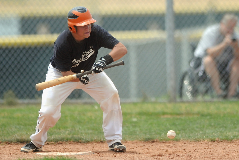Onefifteen's Ty Porterfield lays down a sacrifice bunt during the second game of a doubleheader against the Slammers Grey team at Erie High School on Saturday, July 7, 2012.