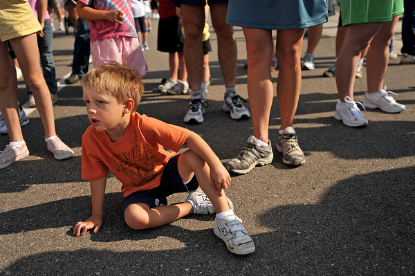 Kai Laplante, 3, waits for the first wave of the children runners to finish Saturday, during the Loveland Classic at Centerra. Laplante was planning on running the half-mile race with his mother, Brodi Caldwell.