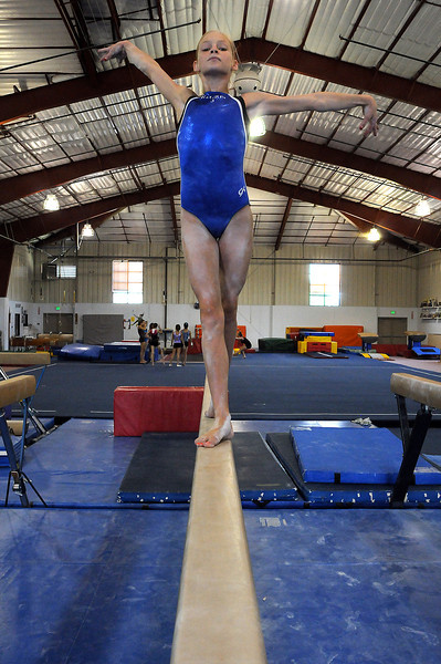 Gymnast Claire Hammen, 13, of Loveland works the balance beam at G.K.'s Gymnastics in Fort Collins. Hammen will compete in the 2009 Cover Girl Classic in Des Moines, Iowa, this weekend.
