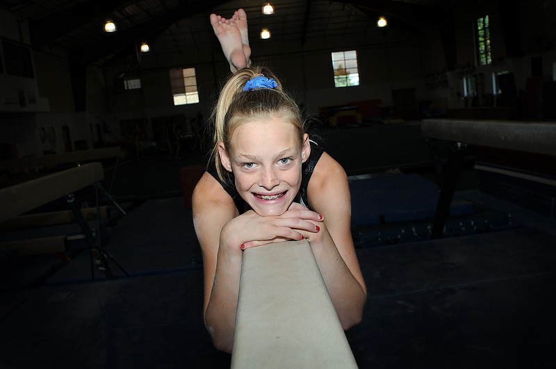 Gymnast Claire Hammen, 13, of Loveland poses on the balance beam at G.K.'s Gymnastics in Fort Collins. Hammen will compete in the 2009 Cover Girl Classic in Des Moines, Iowa, this weekend.