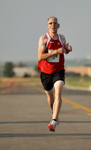 Mike Gates, 27, from Cheyenne, Wyoming is the first to finish the 5K Loveland Classic at Centerra on Saturday morning. The race, which offered both a 5K and a 10K run and two children's races attracted a good number of people.
