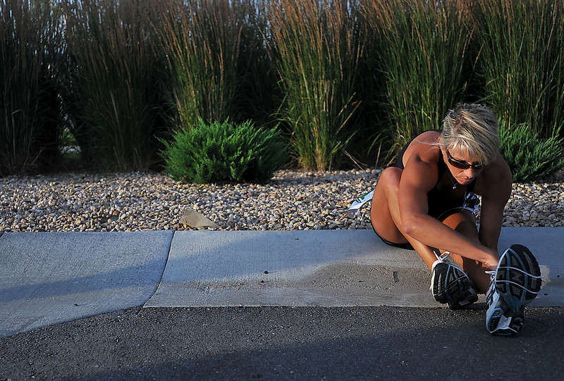 Robbin McWhinney takes time to stretch before participating in the 5K Loveland Classic at Centerra Saturday morning. McWhinney said her goal was to beat her time from last year's race.