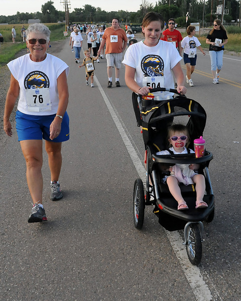 21-month old Lili Wenner participates in the Valley 5000 Friday with her mom, Tasha, and great-grandmother, Sharen Chie, on Friday evening at the start of the event near Fairgrounds Park.