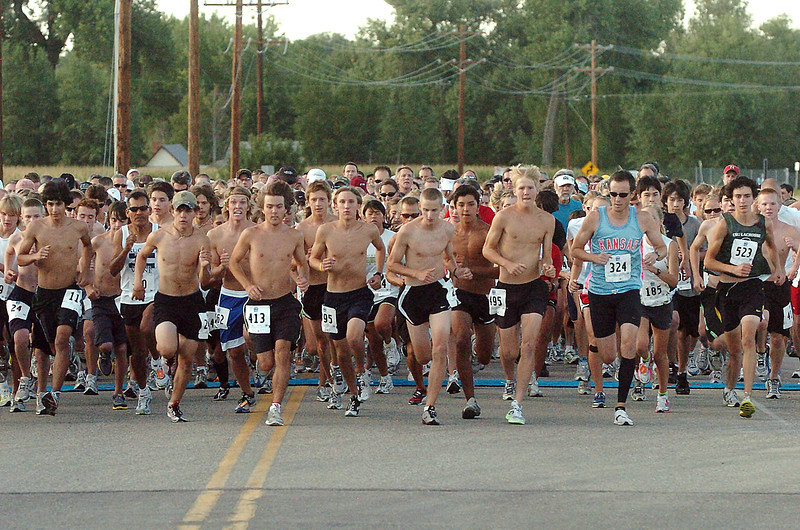Runners take off from the starting line Friday evening near Fairgrounds Park during the Valley 5000 race through Loveland.