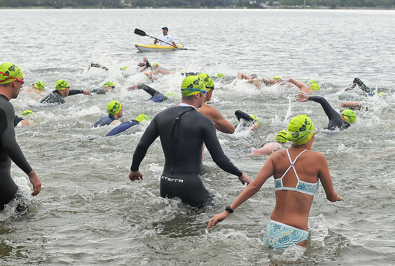 A wave of swimmers enters Lake Loveland at the start of the Loveland Sprint Triathlon on Saturday at North Lake Park.