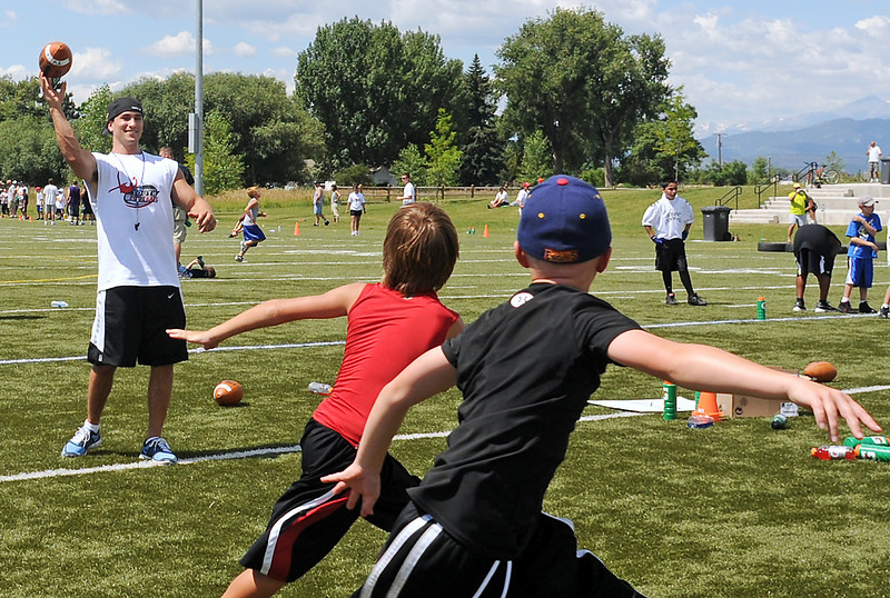 Jeremy Bloom throws a pass during a drill Saturday at his youth football camp at the Loveland Sports Park.
