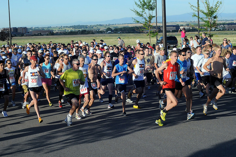 Runners take off at the start of the Loveland Classic road race on Saturday morning at the Centerra Autoplex.