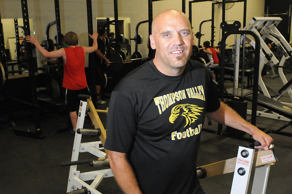Thompson Valley High School football coach Michael DeWall was one of the lucky few, a Thompson School District teacher who was let go because of teacher cuts, but was able to find a spot back in his school. It also makes him a member of another rare crowd -- high school coaches who actually teach in the school they coach. Photo by Steve Stoner