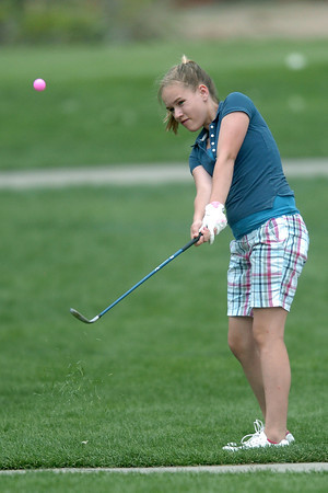 Aryn McLaughlin, 13, hits a chip shot on No. 8 while playing in the Loveland Breakfast  Optimist Junior Golf Tournament on Monday, June 6, 2011 at The Olde Course at Loveland.