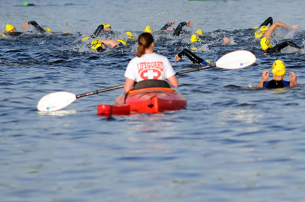 Swimmers make their way across Lake Loveland at the start of one of the waves of competitors Saturday morning during the Lake To Lake Triathlon.