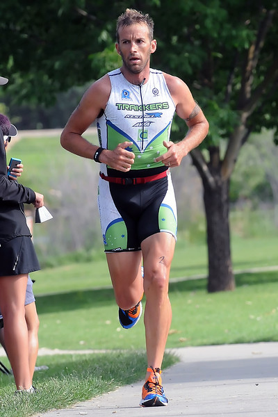 Chris McDonald of Tuscon, AZ heads for the finish line on his way to a first-place finish in the men's division of the Lake To Lake Triathlon on Saturday morning at North Lake Park.