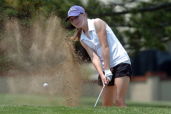 Kelsey Greiner, 16, hits out of a sand trap during the Loveland Breakfast  Optimist Junior Golf Tournament on Monday, June 6, 2011 at The Olde Course at Loveland.