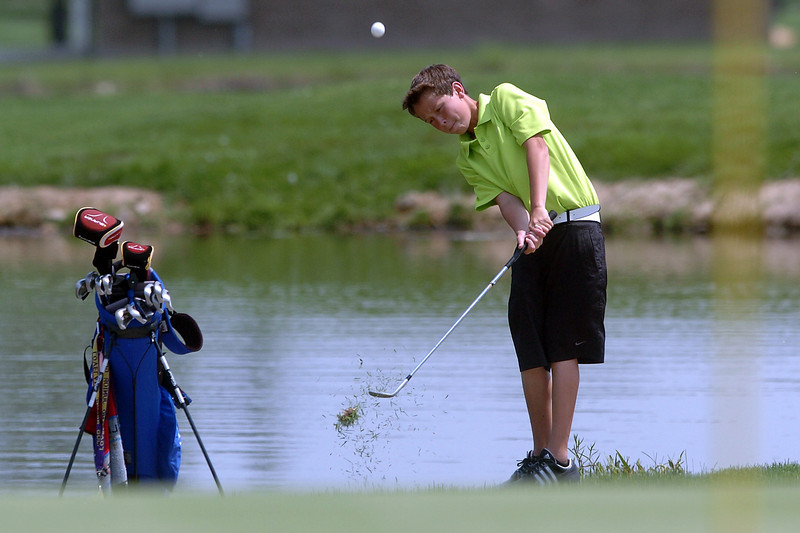 Alec Steine, 15, hits a shot on No. 7 while playin in the Loveland Breakfast  Optimist Junior Golf Tournament on Monday, June 6, 2011 at The Olde Course at Loveland.