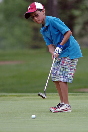 Eleven-year-old Micah Ramirez watches his putt on No. 9 while playing in the Loveland Breakfast Optimist Junior Golf Tournament on Monday, June 6, 2011 at The Olde Course.