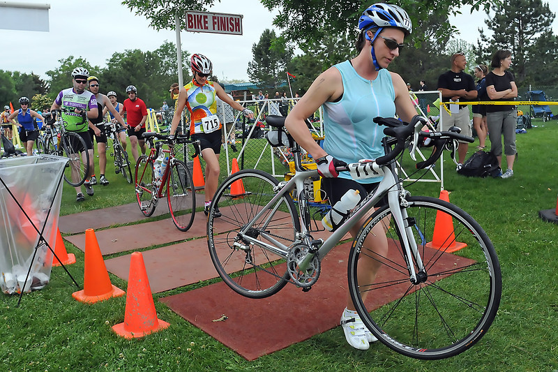 Athletes competing in the Lake To Lake Triathlon head out on their bicycles after completing the swimming portion of the race Saturday morning at North Lake Park.
