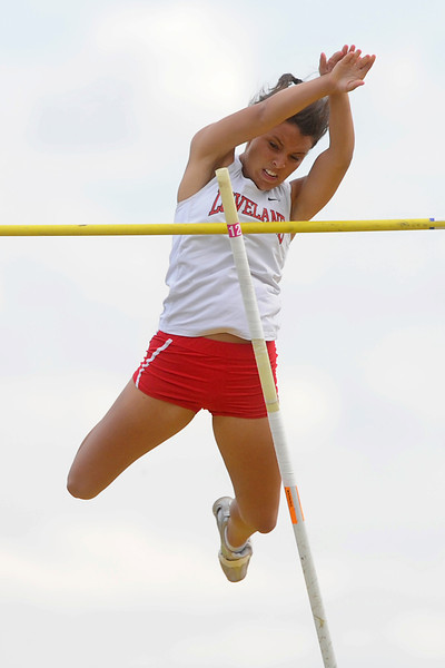 Loveland High School senior Lisa Bohannon clears the bar at 10 feet, 9 inches to win the pole vault event during the R2-J Invitational on Friday, April 20, 2012 at LHS.