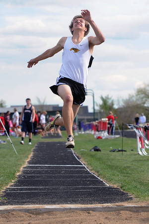 Thompson Valley High School's Nash Doughman flies through the air while competing in the long jump during the R2-J Invitational on Friday, April 20, 2012 at Loveland High School.