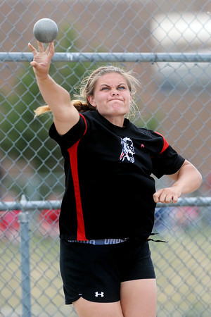 Loveland High School senior Sydnie Spencer competes in the shot put during the R2-J Invitational on Friday, April 20, 2012 at LHS.
