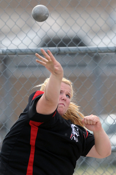 Loveland High School's Anna Gerhard makes a throw while competing in the shot put during the R2-J Invitational on Friday, April 20, 2012 at LHS.