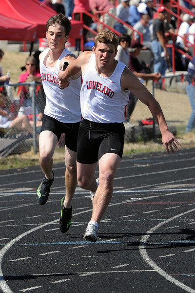 Loveland High School's Mike Zweigle, left, transfers the baton to Sam Kreimier while competing in the 800-meter relay during the R2-J Invitational on Friday, April 20, 2012 at LHS.