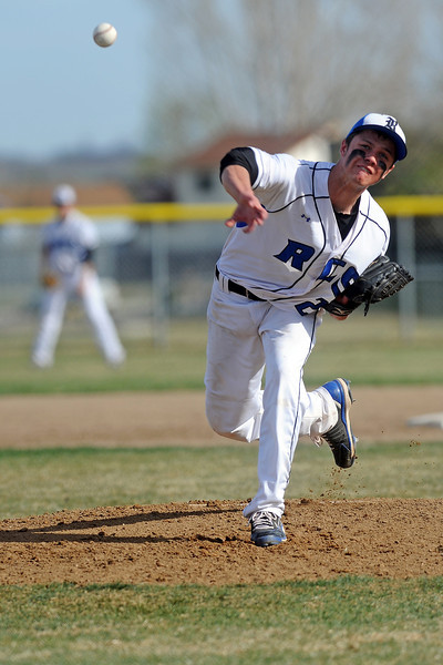 Resurrection Christian School's Kenny Lowry throws a pitch in the bottom of the third inning of a game against Berthoud on Thursday, April 5, 2012 at Sommers Field.