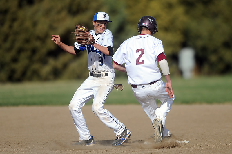 Berthoud High School baserunner Luke Whitfield steals second base ahead of the tag attempt by Resurrection Christian's Brett Bakersky in the bottom of the fourth inning of their game on Thursday, April 5, 2012 at Sommers Field.