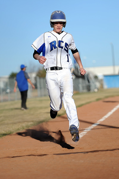 Resurrection Christian School's Josh Miller scores a run in the bottom of the fifth inning of a game against Berthoud on Friday, March 23, 2012 at RCS. The Cougars won in five innings, 12-2.
