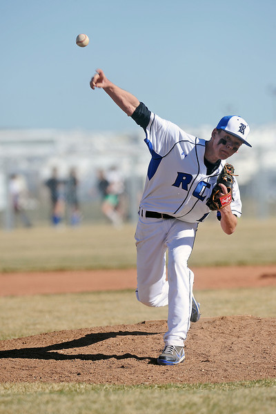 Resurrection Christian School's Aaron Boettger hurls a pitch in the top of the third inning of a game against Berthoud on Friday, March 23, 2012 at RCS. The Cougars won in five innings, 12-2.