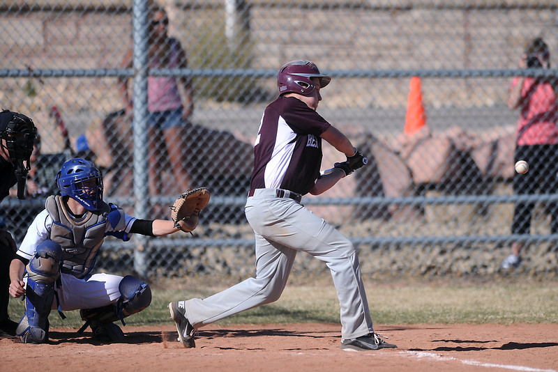 Berthoud High School's Luke Read takes a swing at the plate while Resurrection Christian catcher Chance Richardson looks on in the top of the second inning of their game on Friday, March 23, 2012 at RCS. The Cougars won in five innings, 12-2.