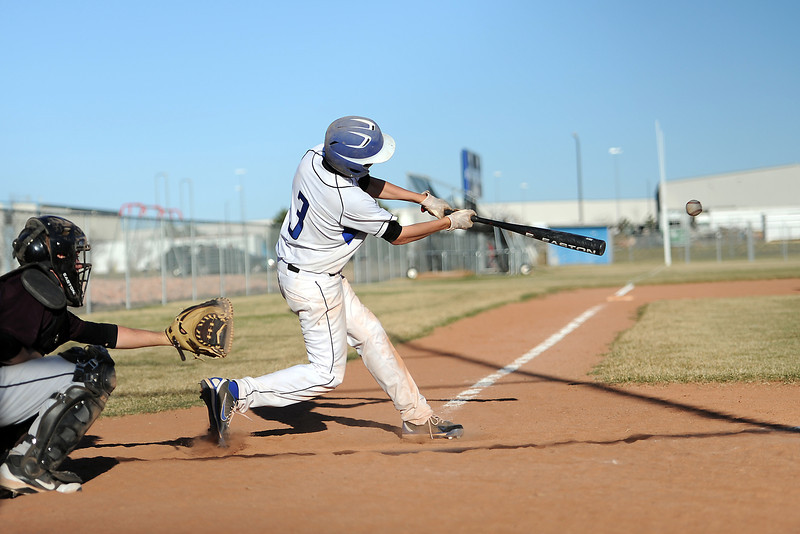 Resurrection Christian School's Brett Bakersky hits a single in the bottom of the fifth inning of a game against Berthoud on Friday, March 23, 2012 at RCS. The Cougars won in five innings, 12-2.