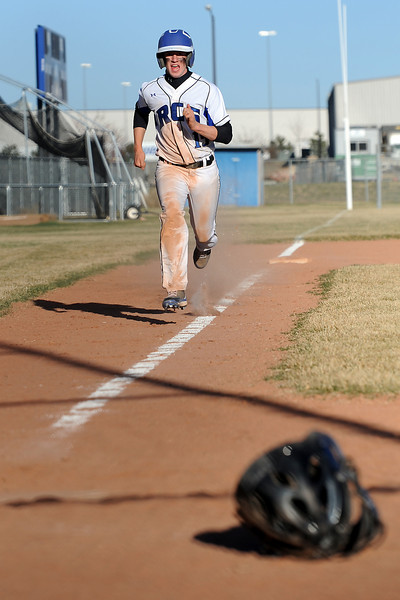 Resurrection Christian School's Lance Harper scores from third base in the bottom of the fifth inning of a game against Berthoud on Friday, March 23, 2012 at RCS. The Cougars won in five innings, 12-2.