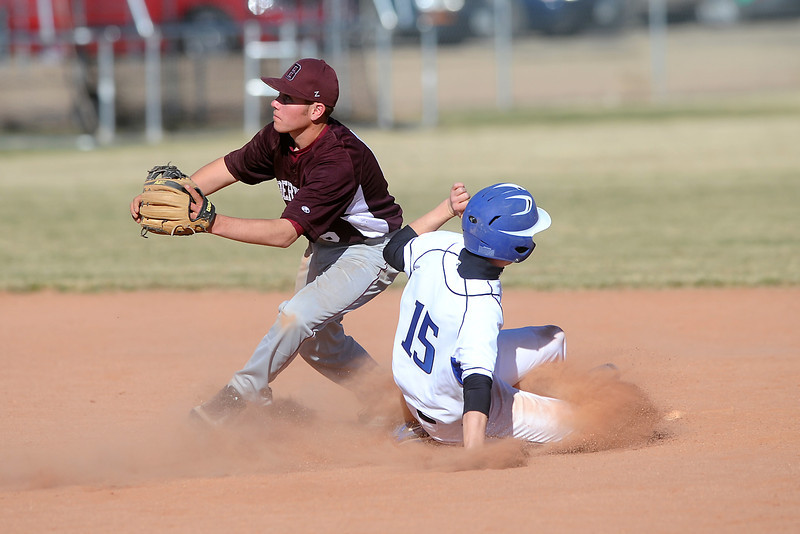 Berthoud High School second baseman waits for the throw from home as Resurrection Christian baserunner Lance Harper safely steals second in the bottom of the third inning of their game on Friday, March 23, 2012 at RCS. The Cougars won in five innings, 12-2.