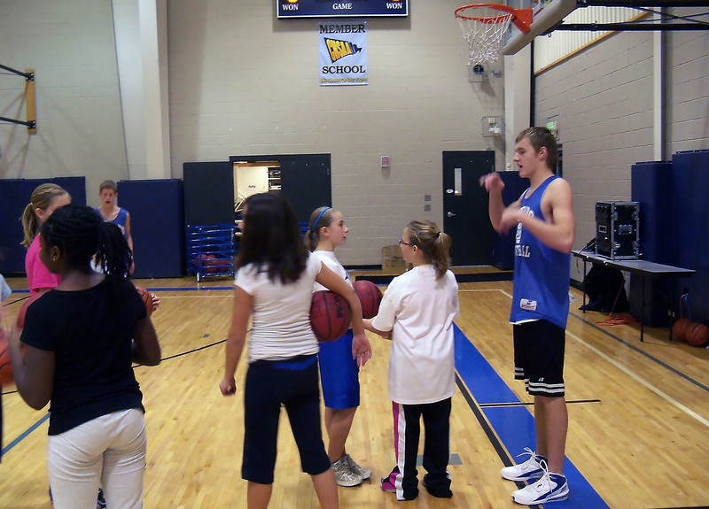 Resurrection Christian School boys basketball player Ethan Bowlin instructs players during a basketball camp at the school Thursday. Area athletes have stayed busy over the holiday break.