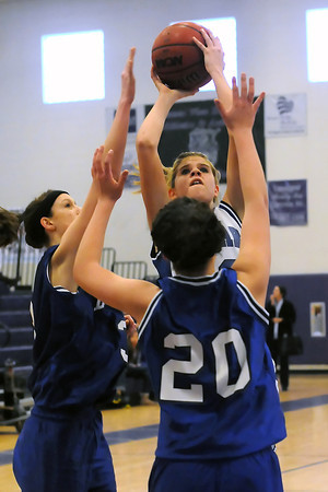 Resurrection Christian School junior Courtney Peterson, back, puts up a shot between Dayspring Christian defenders Mallory Posey, left, and Hannah Donoho in the third quarter of their game on Friday, Feb. 25, 2011 at Mountain View High School during the Class 2A District 7 Basketball Tournament. The Cougars won, 55-43.