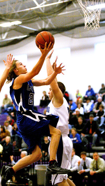 Lyons' Jestin Boldt (No. 25) attempts a layup Saturday, Feb. 25, 2012 in the 2A district 7 tournament championship game at Mountain View High School. Lyons fell short to Resurection, 64-43.