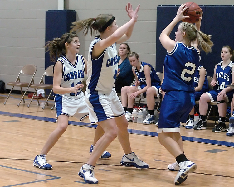 Resurrection Christian School teammates Courtney Peterson, left, and Lindsey Weaver apply backcourt pressure to Dayspring Christian's Brittany Morris in the second quarter of their game on Thursday, Feb. 4, 2010 at RCS. The Cougars won, 53-24.