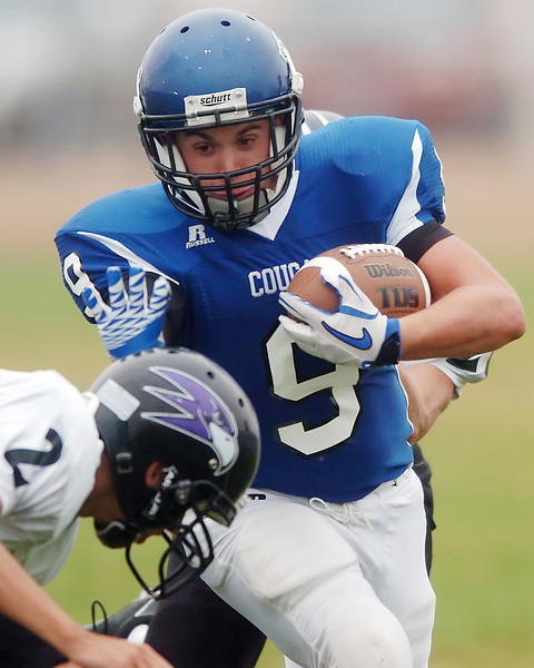 Resurrection Christian School senior Caleb Boehler makes a carry in the second quarter of a game against Front Range Christian School on Saturday at RCS. Boehler had 179 yards rushing and two touchdowns in the Cougars' 28-0 victory over the Falcons.