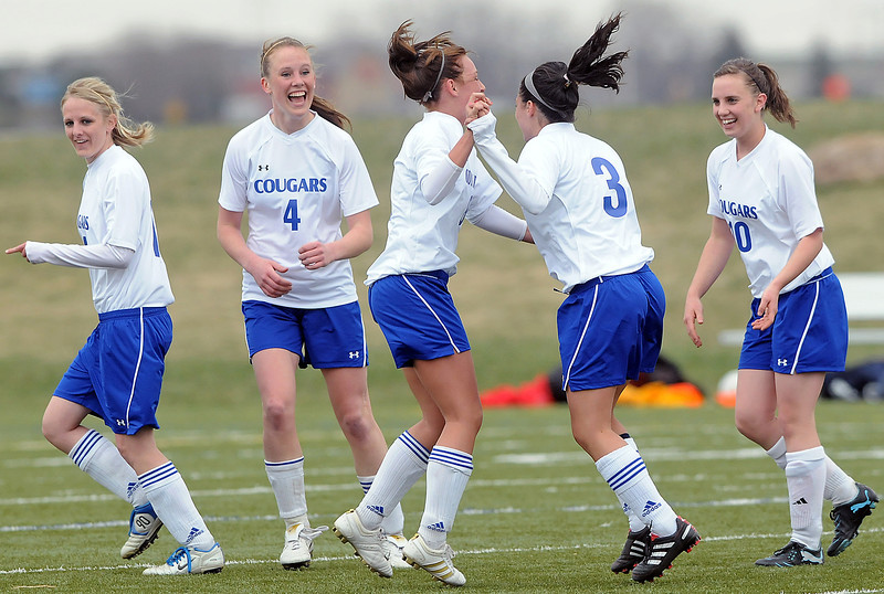 Resurrection Christian School junior Alyssa Parrot, center, celebrates with teammates after scoring a goal in the first half of their game against Frontier Academy on Friday, April 16, 2010 at the Loveland Sports Park. From left are Courtney Brand, Lindsey Weaver, Parrot, Darcy Hummel and Nicole Stevenson. The Cougars won, 8-0.