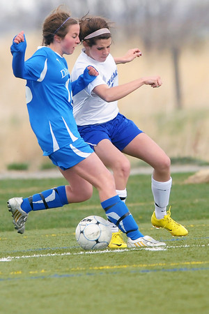 Resurrection Christian School senior Courtney Peterson, right, and Alexander Dawson's Kelly Dulin battle for control of the ball in the second half of their match Friday at the Loveland Sports Park. The Cougars lost, 1-0.