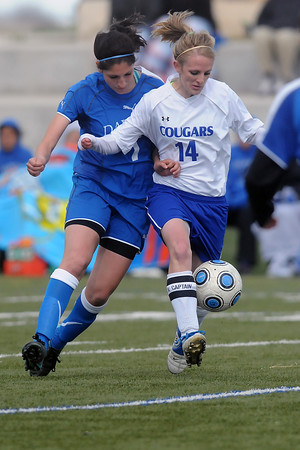 Resurrection Christian School senior Courtney Brand, right, tracks down the ball ahead of Alexander Dawson's Crystal Chavez in the second half of their match Friday at the Loveland Sports Park. The Cougars lost, 1-0.