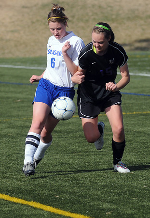 Resurrection Christian School senior Audrey Isabelle, left, collides with Lutheran-Parker's Hayley Merrigan as they battle for control of the ball in the first half of their game Friday at the Loveland Sports Park. The Cougars won, 3-1.