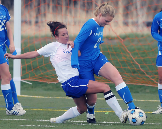 Resurrection Christian School senior Alyssa Parrott, left, goes after the ball against Alexander Dawson's Emily Oliver in the second half of their match Friday at the Loveland Sports Park. The Cougars lost, 1-0.