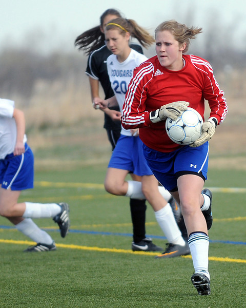 Resurrection Christian School goal keeper Abby Yount looks downfield after making a stop in the second half of a game against Lutheran-Parker on April 8, 2011 at the Loveland Sports Park. The Cougars won, 3-1.